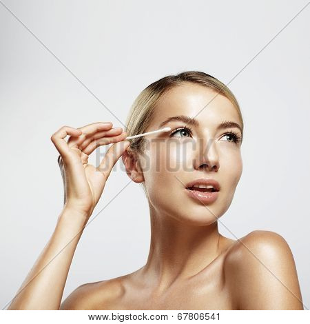 Gorgeous Woman Cleansing Her Face