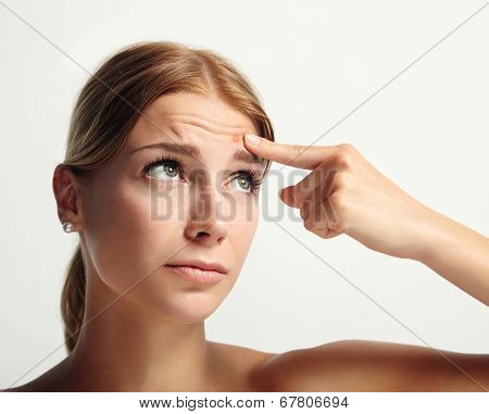 Woman Indicate A Pimple