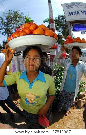 Woman Carrying Oranges On Her Head For Sell.