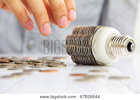 abstract image of coin light bulb,save energy concept