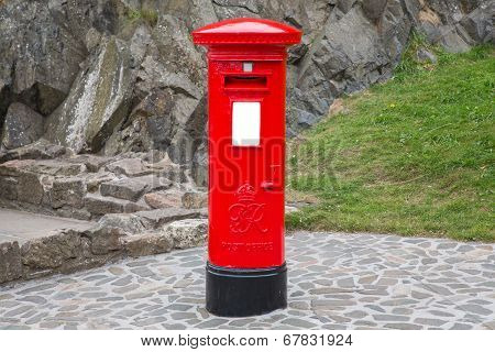 Typical red british postbox