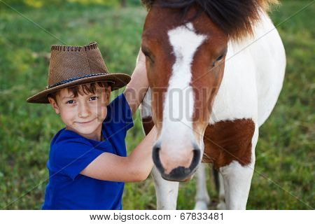 Little Boy With Pony