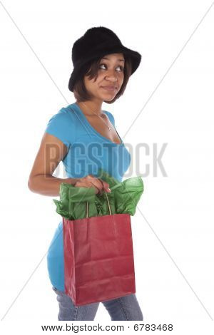 Woman With Gift Bag Looking Curious