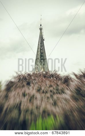 Hdr Shoot, Steeple Behind A Red Tree, With Motion Blur