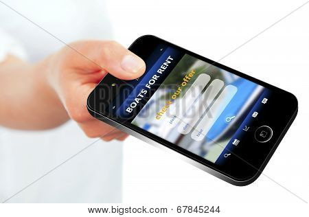 Hand Holding Mobile Phone With  Boats For Rent Offer