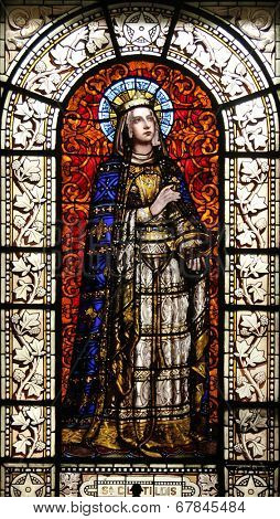 PARIS, FRANCE - NOV 10, 2012: Saint Clotilde, stained glass, Saint-Vincent-de-Paul Church (design Jean-Baptiste Lepere, was built during 1824 - 1844) dedicated to Saint Vincent de Paul