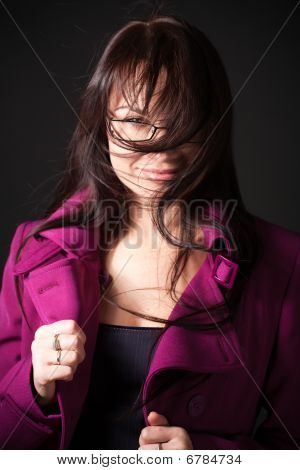 Brunette Woman Dress Pink Coat Under The High Wind