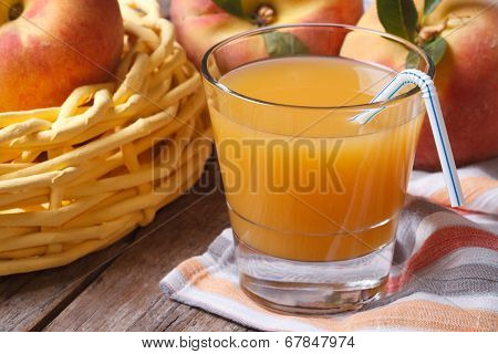 Peach Juice In Glass Closeup On A Table And Fruit. Horizontal
