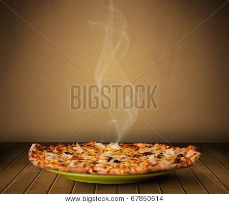 Fresh delicious home cooked pizza with steam on wood deck