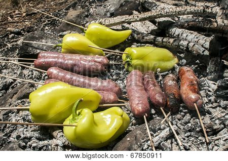 Sausages and peppers on grill