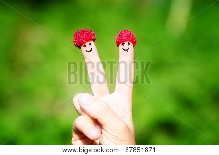 Happy Couple Fingers With Raspberries And Painted Smiles
