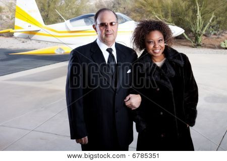Rich Couple Arriving In Style At The Airport