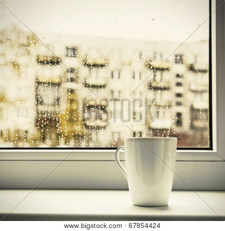 Cup Of Hot Coffee On The Window