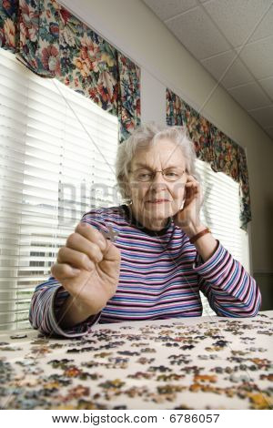 Elderly Woman Doing Jig Saw Puzzle