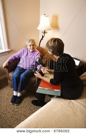 Elderly Woman Having Blood Pressure Taken