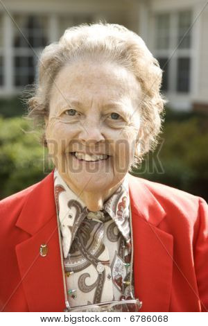 Elderly Woman In Red Coat Outdoors Smiling