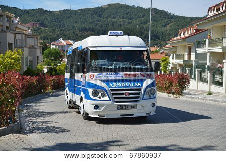 MARMARIS, TURKEY - APRIL 17, 2014: Public minibus to Armutalan on the street of Marmaris. Armutalan is the Europe-like suburb of the Marmaris city with many restaurants and hotels