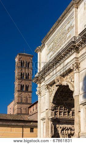 Arc De Titus And Basilica Di Santa Francesca Romana In Rome, Italy