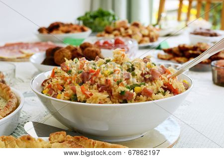 Bowl Of Rice Salad On A Buffet Table