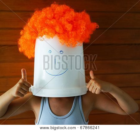 Boy with bucket on his head