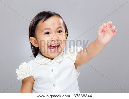 Baby girl excite with hand up