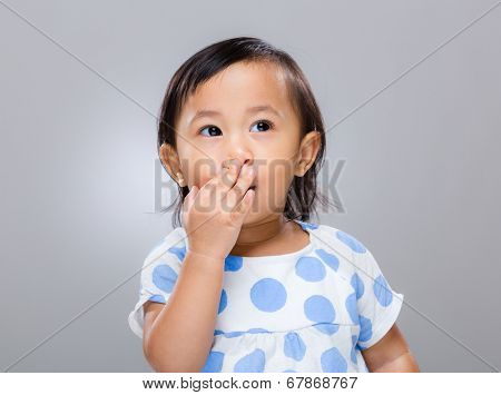 Baby girl with hand cover her mouth