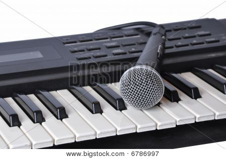 A Microphone Lying On The Keys