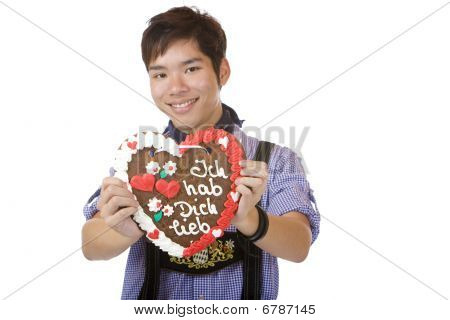 Happy smiling man Holding Oktoberfest Heart In Camera