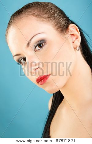Portrait of a beautiful girl on a blue background