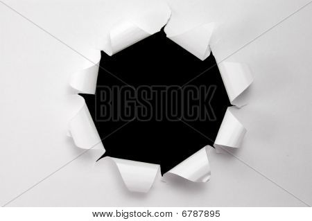 Paper with torn hole
