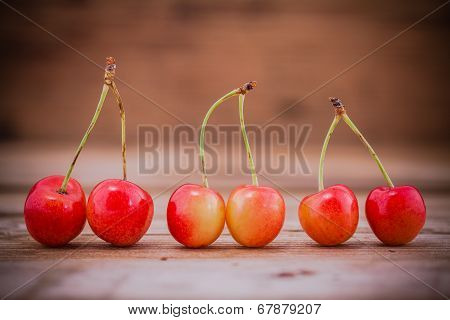 Rainier Cherries On The Old Wooden Background