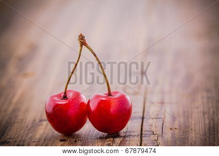 Organic Rainier Cherries On The Old Wooden Background