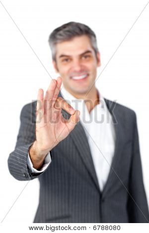 Smiling Mature Businessman Showing Ok Sign
