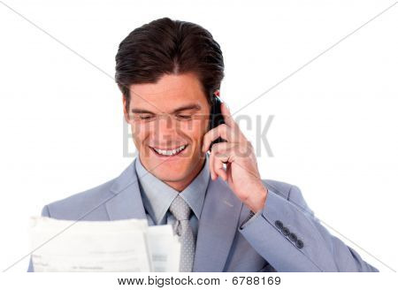 Happy Businessman On Phone Holding A Newspaper
