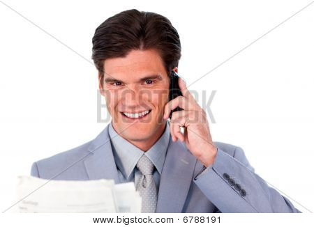 Assertive Businessman On Phone Holding A Newspaper