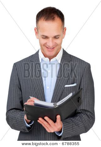 Arttractive Businessman Consulting His Agenda