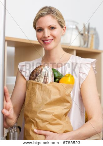 Attractive Woman Holding A Grocery Bag