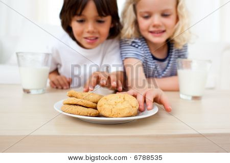 Adorable Siblings Eating Biscuits