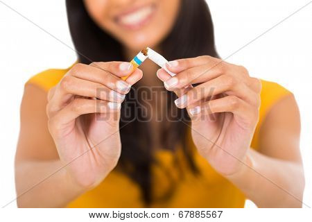 close up portrait of woman breaking a cigarette