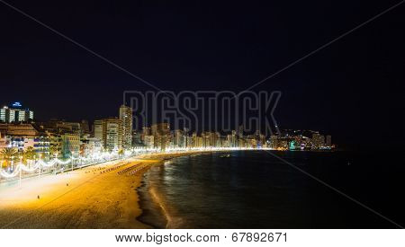 BENIDORM, SPAIN - SEPTEMBER 13: Benidorm city beach at night on September 13, 2012 in Benidorm, Spain. View on night Benidorm city and the beach.