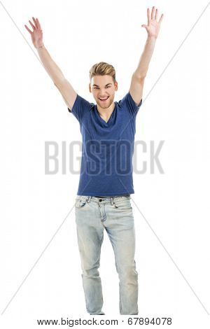 Happy and good looking young man with both arms up, isolated on white background