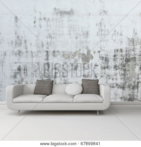 Greyscale image of an upholstered white sofa against an abstract wall with a grunge rustic pattern over a plain white floor with skirting board