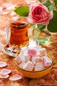 foto of desert-rose  - Bowl with diced Turkish delight tea and rose - JPG