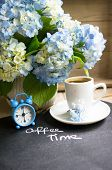 stock photo of hydrangea  - Hydrangea flowers in a vase cup of coffee and note