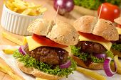 stock photo of beef-burger  - Beef burgers with cheese and vegetables - JPG