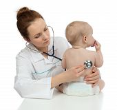 stock photo of auscultation  - Doctor or nurse auscultating child baby patient heart with stethoscope physical therapy closeup composition on a white background - JPG