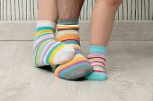 foto of stocking-foot  - feet of a beautiful family with striped socks - JPG