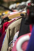 foto of thrift store  - clothes on a rack on a flea market.