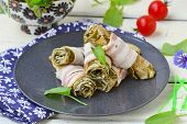 stock photo of sorrel  - Rolls from an omelet with a sorrel and bacon for breakfast - JPG