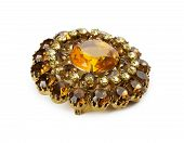 stock photo of brooch  - vintage brooch with gemstones on the white background - JPG